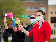 """06 MAY 2020 - DES MOINES, IOWA: Members of the nursing staff at Unity Point Health Iowa Methodist Medical Center in Des Moines, wave to passing police and fire vehicles as they drive past the hospital. Des Moines first responders, the Iowa State Patrol, and utility companies made an """"Appreciation Loop"""" around the hospital on National Nurses' Day to thank nurses and other care givers at the hospital for the care they are providing during the COVID-19 (Coronavirus/SARS-CoV-2) pandemic. Iowa reported 10,404 confirmed cases of COVID-19 statewide Wednesday, about 2,500 cases in the Des Moines metropolitan area. Acting against the advice of many medical professionals, the Governor of Iowa has started reopening businesses in the state. Businesses in the Des Moines area, and other communities with a high number of cases are not allowed to reopen.       PHOTO BY JACK KURTZ"""