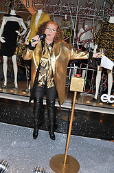 JENNIFER SAUNDERS as her TV character Edina Monsoon at a party to celebrate the switching on of the Christmas Lights at the Stella McCartney store, Bruton Street, London on 29th November 2011.
