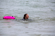 Award winning actress and Folkestone resident Jessica Hynes took part in a  4 mile sea swim on the 7th of July 2020 with 12 laps of Folkestone sunny sands bay to raise money for charity in Folkestone, Kent. She swam for two different charities, one being the Folkestone community hub, which has been supporting vulnerable people during the Covid-19 lockdown and the second called Green Kordofan which supports children in a refugee camp in Yida, South Sudan. Mrs Hynes is one of many volunteers who have worked at the hub, which provides help by delivering groceries, collecting prescriptions or just being a voice on the end of the phone.The second charity is Green Kordofan, which supports children in a refugee camp in Yida, South Sudan and was founded by Raga Gibreel, also from Folkestone.The registered charity is currently raising money for essential hygiene facilities such as washing and toilet blocks, to make the camp safe for the children who have been displaced by war. (photo by Andrew Aitchison / In pictures via Getty Images)