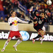 Marcelo Saragosa, D.C. United, clears from Kenny Cooper, Red Bulls,  during the New York Red Bulls V D.C. United Major League Soccer, Eastern Conference Semi Final 2nd Leg match at Red Bull Arena, Harrison. New Jersey. USA. 8th November 2012. Photo Tim Clayton