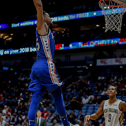 Dec 10, 2017; New Orleans, LA, USA; Philadelphia 76ers guard Ben Simmons (25) dunks over New Orleans Pelicans guard Rajon Rondo (9) during the fourth quarter at the Smoothie King Center. The Pelicans defeated the 76ers 131-124. Mandatory Credit: Derick E. Hingle-USA TODAY Sports