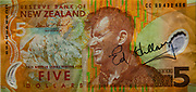 New Zealand $5 bank note with Ed Hillary portrait and Colin Monteath image of Aoraki Mount Cook Caroline face. Signed by Ed Hillary.