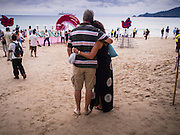 26 DECEMBER 2014 - PATONG, PHUKET, THAILAND: Tourists watch the memorial for the 2004 tsunami on Patong Beach in Patong, Phuket. Hundreds of people died in Patong and nearly 5400 people died on Thailand's Andaman during the 2004 Indian Ocean Tsunami that was spawned by an undersea earthquake off the Indonesian coast on Dec 26, 2004. In Thailand, many of the dead were tourists from Europe. More than 250,000 people were killed throughout the region, from Thailand to Kenya. There are memorial services across the Thai Andaman coast this weekend.    PHOTO BY JACK KURTZ