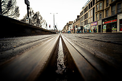 Low angle view of tram track on Princes Street in Edinburgh, Scotland, UK