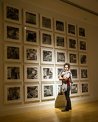 Pictured: Adeline Amar admires  Parking Lot series 1 (1967-99)<br /> Ed Ruscha exhibition. Titled, Music from the Balconies, it is the artist's first exhibition at the gallery for a decade<br /> <br /> <br /> Ger Harley | EEm 28 Aprl 2017