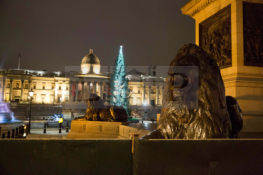 © Licensed to London News Pictures.31/12/2020, London, UK. A barrier is erected around Trafalgar Square, central London as New Year celebration was prohibited as three quarters of England plunged into Tier 4 last night. This New Year's Eve Londoners need to stay at home according to Tier 4 guidelines. Photo credit: Marcin Nowak/LNP