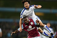 Shinji Okazaki of Leicester city takes a tumble over Jores Okore of Aston Villa. Barclays Premier league match, Aston Villa v Leicester city at Villa Park in Birmingham, The Midlands on Saturday 16th January 2016.<br /> pic by Andrew Orchard, Andrew Orchard sports photography.