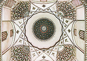 Stunning photographs reveal the beautiful ceilings in Iran's mosques, bazaars and public baths<br /> <br /> For the past few decades, restrictions on travel to Iran has meant the country has been largely shut off from the Western world, butas visa sanctions are lifted in the light of a landmark nuclear deal, the local tourism industry is hoping for a flurry of visitors.<br /> It's not hard to see why Iran is listed as one of the top travel destinations of 2016, with its rich culture and history.<br /> Among the standout aspects of the nation is its beautiful ancient architecture, with the cities and towns littered withornate and eye-catching mosques, public baths and markets.<br /> And unlike many other countries - the roof is not an afterthought, with many ceilings built as the centrepiece to the building, with many of the tile designs showcasing a display of intricate geometric patternsthatdate back several centuries.<br /> French photographerEric Lafforgue has travelled the country photographing the ceilings of indoor markets, mosques and bath houses.<br /> <br /> Photo shows: ceiling with its intricate and elaborate patterns in three domes moshtaghie, Central County, Kerman, Iran