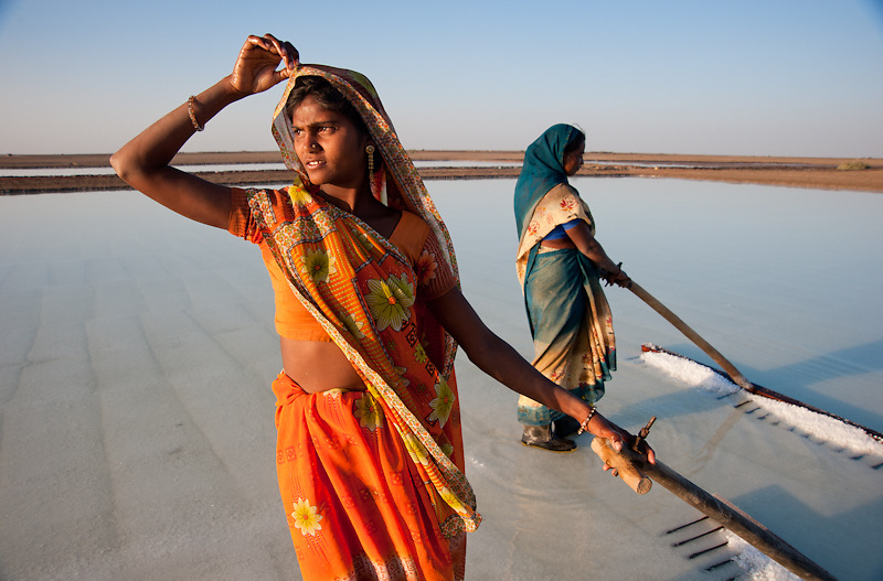 Young women, saltworkers in India, face the blistering heat to earn a living.