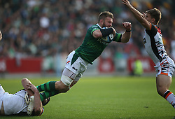 London Irish's Sean O'Brien (centre) is tackled by Leicester Tigers' Marco van Staden (left) during the Gallagher Premiership match at the Brentford Community Stadium, London. Picture date: Saturday October 9, 2021.
