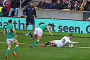 Elliott Daly of England scores a try during the Six Nations international rugby union match between England and Ireland at Twickenham stadium, Sunday, Feb. 23, 2020, in London, United Kingdom.  England won the match 24-12. (Mitchell Gunn/ESPA-Images-Image of Sport)