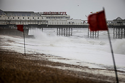 © Licensed to London News Pictures. 30/07/2021. Brighton, UK. Red flags on the beach at Brighton warn swimmers against entering the sea in windy conditions. Parts of the south are feeling the effects of Storm Evert, the first named storm of summer 2021. Photo credit: Peter Macdiarmid/LNP