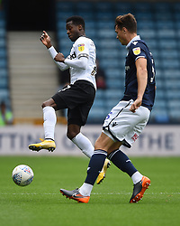 Millwall's Jake Cooper and Derby County's Florian Jozefzoon battle for the ball