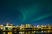 Aurora Borealis, Saskatoon downtown skyline at night and Broadway Bridge over the South Saskatchewan River.