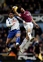 Photo: Olly Greenwood.<br />West Ham United v Portsmouth. The Barclays Premiership. 26/12/2006. Portsmouth's Pedro Mendes goes for the ball with West Ham's Yossi Benayoun