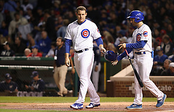 September 8, 2017 - Chicago, IL, USA - The Chicago Cubs' Anthony Rizzo hands his helmet over to the bat boy after striking out to end the first inning against the Milwaukee Brewers at Wrigley Field in Chicago on Friday, Sept. 8, 2017. (Credit Image: © Chris Sweda/TNS via ZUMA Wire)
