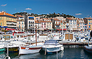 In the harbour in Cassis village.  Fishing and liesure boats moored at the key side. Cassis Cote d'Azur Var France Bouches du Rhone