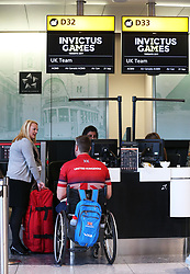 Competitor Steven Palmer at the check-in desk at Heathrow Airport, as the 90-strong team of wounded, injured and sick military personnel and veterans representing the UK depart for the 2017 Invictus Games in Toronto.