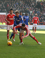 Birmingham City's Andrew Shinnie (C) and Nottingham Forest's Henri Lansbury (R) in action during todays match  <br /> <br /> Photographer Jack Phillips/CameraSport<br /> <br /> Football - The Football League Sky Bet Championship - Nottingham Forest v Birmingham City - Saturday 28th December - The City Ground - Nottingham<br /> <br /> © CameraSport - 43 Linden Ave. Countesthorpe. Leicester. England. LE8 5PG - Tel: +44 (0) 116 277 4147 - admin@camerasport.com - www.camerasport.com