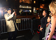 l to r: Russell Simmons and his sister-in-law Justine Simmons, Russ Simmons at The Life Project for Africa Benefit for the NJIA Health Center in Tanzania, Africa and held at Ben and Jack's Restaurant on November 10, 2009 in New York City