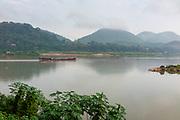 Morning scene along the Mekong River where the Nam Khan River enters, Luang Prabang, Laos.