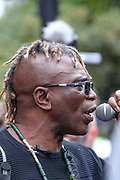 The black community activist Ken Hinds who accused police of discrimination after he was threatened with arrest and prosecution for organising anti-racism protest march in London addresses the mass of anti-racism protesters march towards Hyde Park in London on Sunday, Aug 30, 2020. (VXP Photo/ Vudi Xhymshiti)