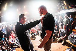 Tommy Blom explains to the students the next knife defence exercise. IKMS 'In The Club' seminar with KMG Global Team Instructor and Expert Level 5, Tommy Blom, at the Buff Club in Glasgow's City Centre. Bringing Krav Maga training out with the confines of the gym into a real nightclub/bar.<br /> © Michael Schofield.