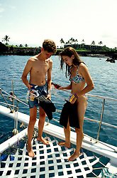 Hawaii, Big Island, Snorkelers, snorkeling, Kona Coast, model released.  Photo: family103  .Photo copyright Lee Foster; 510/549-2202; lee@fostertravel.com; www.fostertravel.com.