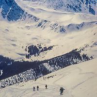 Skiers enter Spaulding Bowl at Copper Mountain Ski Area, Colorado.