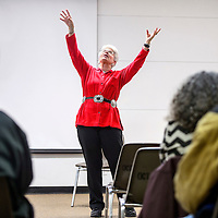 Mary Ellen Gonzales makes theatrical gestures during a storytelling performance at the Octavia Fellin Public Library in Gallup Thursday.