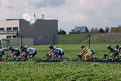 Peloton speed through the industrial areas that surround Dottignies - Grand Prix de Dottignies 2016. A 117km road race starting and finishing in Dottignies, Belgium on April 4th 2016.