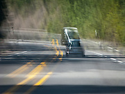 scene along a cross country trip with in a classic Mini Cooper auto - whizzing through the Oregon Cascade Range in a classic Mini Cooper automobile motion blur vibration from a rough ride