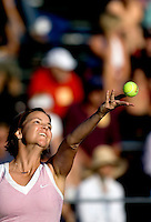 New Haven, Conn.-19 August 2008- Lindsay Davenport serves to doubles team Jill Craybas and Olga Govortsova during Tuesday's Pilot Pen match, in which Davenport was teamed with Daniela Hantuchova, at the Connecticut Tennis Center at Yale...Josalee Thrift Photo