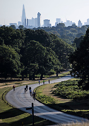 © Licensed to London News Pictures. 01/09/2019. London, UK. Cyclists enjoy the warm, bright morning on the first day of meteorological autumn in Richmond Park, west London. Photo credit: Ben Cawthra/LNP