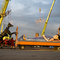 LIVERPOOL, UK, 20th April, 2012. The Sea Odyssey. The giant dog, Xolo, pushes the little girl giant around in her bed.