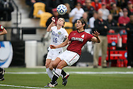 04 December 2011: Stanford's Alina Garciamendez (4) and Duke's Molly Lester (15). The Stanford University Cardinal defeated the Duke University Blue Devils 1-0 at KSU Soccer Stadium in Kennesaw, Georgia in the NCAA Division I Women's Soccer College Cup Final.