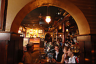 Patrons enjoy a meal and beverage at a Irish pub in Winter Park, Florida.