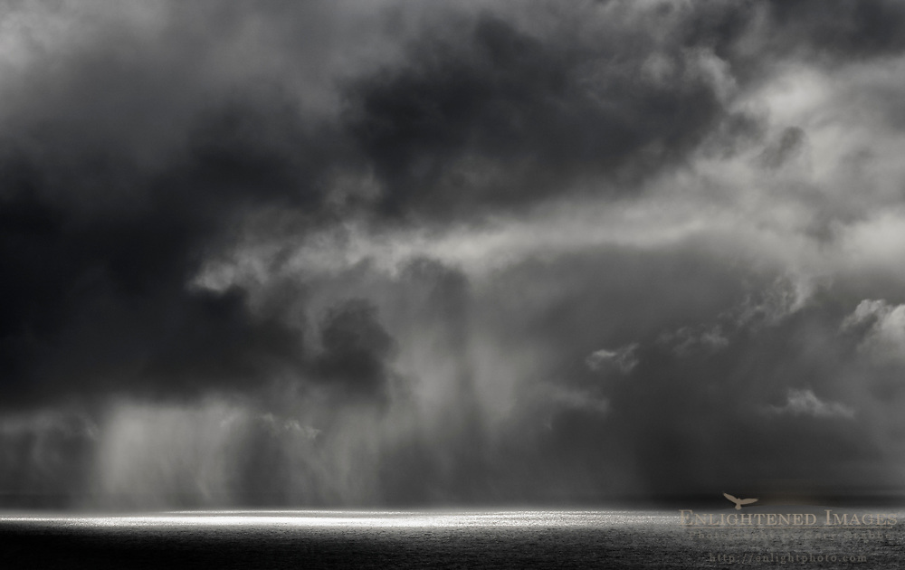 Clouds, sunlight, and rain over the Pacific Ocean from Point Reyes National Seashore, Marin County, California