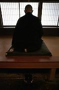 "LIVING ZEN - HOSHINJI MONASTERY, OBAMA-JAPAN..Monk in ""Zazen"" meditation position in the Zento."