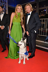 NICKY CLARKE and KELLY SIMPKIN with Battersea dog Skye at Battersea Dogs & Cats Home's Collars & Coats Gala Ball held at Battersea Evolution, Battersea Park, London on30th October 2014.