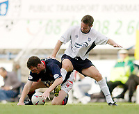 Photo. Jed Wee<br /> Preston North End v Sunderland, Nationwide League Division One, Deepdale, Preston. 23/08/2003.<br /> Sunderland striker Kevin Kyle (L), with a bleeding headwound, continues to scrap for the ball against Preston's Graham Alexander.