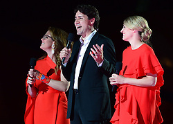 Prime Minister Justin Trudeau and wife Sophie Gregoire Trudeau speak alongside Minister of Canadian Heritage Melanie Joly, right, during the evening ceremonies of Canada's 150th anniversary of Confederation, in Ottawa on Saturday, July 1, 2017. Photo by Sean Kilpatrick/CP/ABACAPRESS.COM