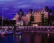 Dusk descending over the Empress Hotel exhibiting the elegance of the Edwardian Age, designed by Francis Rattenbury, built in 1908, Victoria, British Columbia, Canada.