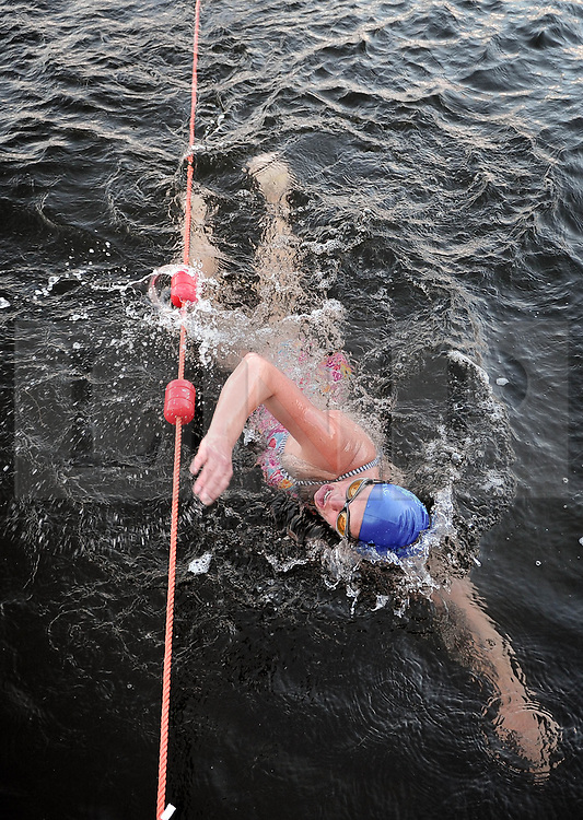 (c) Licenced to London News Pictures 31/01/2015. Low Wood Bay Marina, Windermere, Cumbria, UK. Competitors take part in the Chill Swim 2015 in Windermere today, 31st January 2015. An outdoor swimming event with no wetsuits allowed, the water temperature is around 5 degrees. Photo credit : Harry Atkinson/LNP