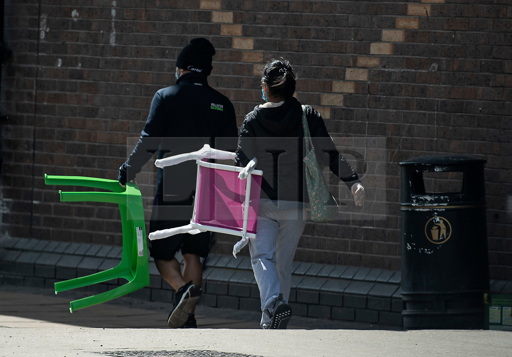 © Licensed to London News Pictures. 25/04/2020. London, UK. Shoppers leaving B&Q in Cricklewood, North London with items perched in store, during Coronavirus Lockdown. The public have been told they can only leave their homes when absolutely essential, in an attempt to fight the spread of coronavirus COVID-19 disease. Photo credit: Ben Cawthra/LNP
