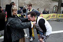 A runner receives their finishers medal after completing the 2018 London Landmarks Half Marathon. PRESS ASSOCIATION Photo. Picture date: Sunday March 25, 2018. Photo credit should read: John Walton/PA Wire