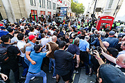 "Protestors scuffle with Police nearby Canada House in Central London, on Saturday Sept 19, 2020 - after thousands gathered in London's Trafalgar Square from across the UK to protest against coronavirus restrictions and reject mass vaccinations. The event, which began at noon, drew a broad coalition including coronavirus sceptics, 5G conspiracy theorists and so-called ""anti-vaxxers"". Speakers at the event accused the government of attempting to curtail civil liberties. (VXP Photo/ Vudi Xhymshiti)"