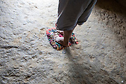Before of lying down on the wapishana hammock, the Amerindian people clean their feet on a small carpet (South Rupununi)