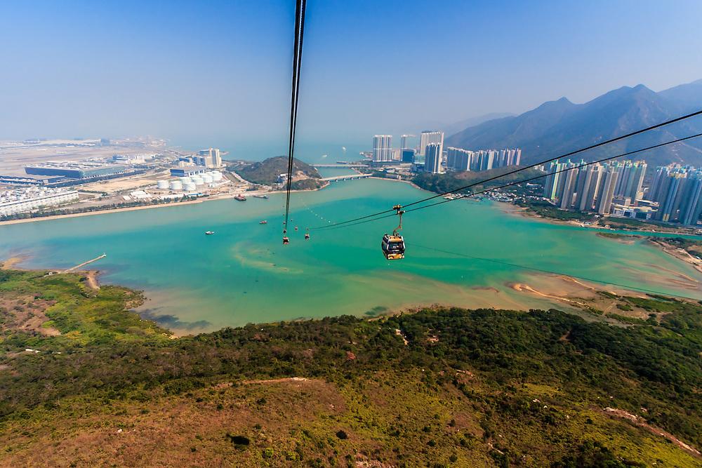 The Ngong Ping gondola in Lantau Island in Hong Kong. The Ngong Ping gondola provides spectacular panoramic views of North Lantau Country Park, the Tian Tan Giant Buddha, the South China Sea and Hong Kong International Airport. The 5,7 km long ride takes passengers to the Po Lin Monastery.