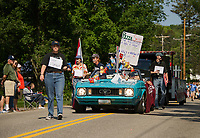"Grace Mclaughlin (as Sean) leads her float ""The Village Store"" a small town tradition with Dan McLaughlin (as Norm) Alexa Smith (hoisting the pizza specials), Bec Pouliot and Scott Menefee (as the old men of the Village Store) and Hayden McLaughlin (as the driver) during the Gilford Old Home Day parade on Saturday.   (Karen Bobotas/for the Laconia Daily Sun)"